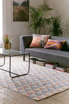 LIke this rug...also like the books stacked under the couch.  Assembly Home Loretta Triangle Printed Rug