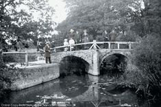 Reigate, Ricebridge On The Mole 1886. A group, thought to be part of a 'walking party', pose rather self-consciously on the two-arched bridge over the River Mole. This stands across the fields some two miles to the south west of Reigate.