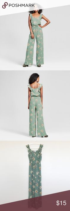 Floral Ruffle Front Jumpsuit Look pretty and polished while you soak up the sun in this ruffle front jumpsuit™. A graphic floral motif updates the look of this wide-leg jumpsuit that's versatile enough for brunch and weekend outings. Delicate ruffles sway along the front and back, giving dimension to the statement piece.   Slight wear on hem (see photo), but no other stains, holes, or other damage. In excellent condition, comes from a smoke-free home. Xhilaration Pants Jumpsuits & Rompers