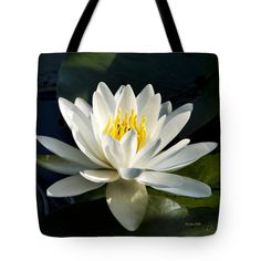 """White Flower Water Lily Tote Bag by Christina Rollo (18"""" x 18"""").  The tote bag is machine washable, available in three different sizes, and includes a black strap for easy carrying on your shoulder.  All totes are available for worldwide shipping and include a money-back guarantee."""