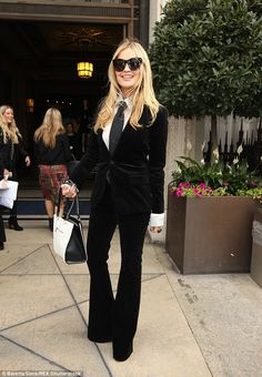 Fashionista: Continuing the androgynous vibe, Laura teamed the style with a white shirt, which featured statement cuffs, and a black tie