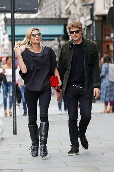 Loved up: Kate Moss, 43, was spotted walking hand in hand with toyboy beau Nikolai von Bismarck, 30, as they visited the theatre together on Friday
