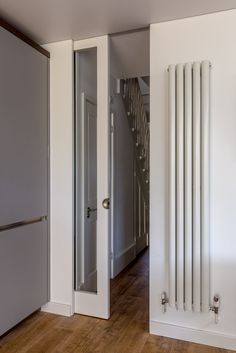 Tall radiator - idea of ground floor front dining room, either side of window