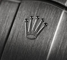 The Rolex crown stamped on the clasp of every Oyster Perpetual is a telling symbol of quality.
