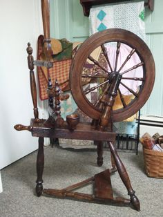 This looks like my antique Spinning wheel!  Mine is about 2 ft tall, it was made for a little girl over 200 yrs  ago.  I love it, and my cousin who gave it to me!