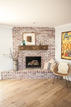 Custom brick fireplace with antique white mortar and custom reclaimed barn wood mantel - as featured on 'Rafterhouse' pilot episode on HGTV.
