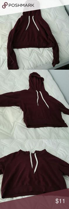 H&M Maroon Crop Sweatshirt Cropped maroon/burgundy sweatshirt from H&M. Worn a few times but shows no visible signs of wear. Can be layered with a tank top or tee for colder weather. Great for the beach. Size M but would fit a small or large Brandy Melville Tops Crop Tops