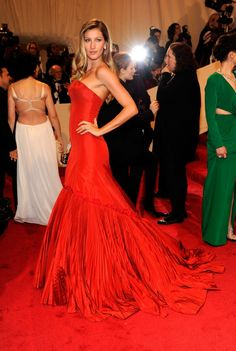 Pin for Later: See 100+ Insanely Gorgeous Looks From Met Galas Past Gisele Bundchen Gisele Bundchen was the belle of the ball in 2011, wearing a simply striking red Alexander McQueen gown in the late designer's honor.