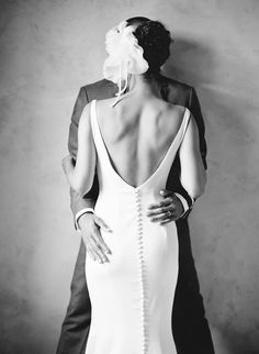 Beautiful way to show off the back of her gown. Photo by Elizabeth Messina