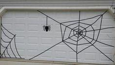 Halloween garage door spiderweb using electrical tape Garage Door Halloween Decor, Garage Door Decor, Halloween Door Decorations, Diy Halloween Decorations, Garage Doors, Garage Halloween Party, Halloween Porch, House Decorations, Holidays Halloween