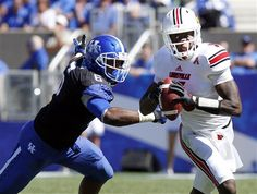 Louisville's Teddy Bridgewater eludes the grasp of Kentucky's Jason Hatcher in the fourth quarter to beat UK 27-13   9/14/13
