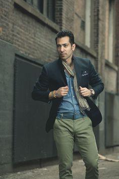 Shop this look on Lookastic:  http://lookastic.com/men/looks/olive-chinos-blue-denim-shirt-black-blazer-olive-scarf/8076  — Olive Chinos  — Blue Denim Shirt  — Black Blazer  — Olive Scarf
