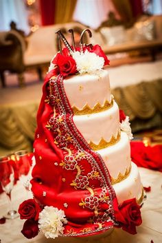 An idea for Indian wedding cake toppers - may look more striking against a lighter cake.