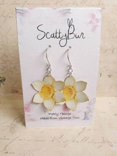 Spring daffodils from a Whittards tin, hand-cut by ScattyBun https://www.etsy.com/uk/listing/601106731/recycled-tin-earrings-handmade-by