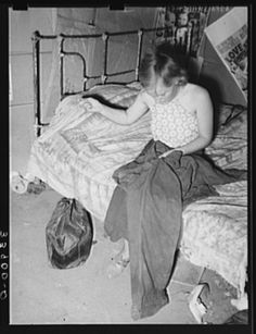 Young married girl living in Mays Avenue camp patching her husband's overalls. Oklahoma City, Oklahoma Photo 1939 by Russell Lee Great Depression, Old Pictures, Old Photos, Vintage Photographs, Vintage Photos, Grapes Of Wrath, Dust Bowl, Make Do And Mend, Photography