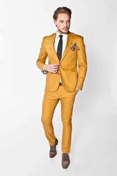 Bold colored suit - love it! Makes a statement and leaves people remembering you, while still looking fantastic. Great for parties and interviews.