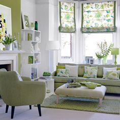 This white and green living room is alive with style. very inviting, great patterns and accents, modern furniture. Really like this space.