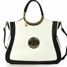 Gorgeous handbag!! I have 2 available in stock! A real eye catcher! Leather like handbag with Gold toned hardware,top Zip closure, large compartment beautiful Burgundy linings inside zipper pocket Cellphone compartment Exterior back zipper 7 inch handle drop comes with detachable strap. 12x15x5x5 inch Bags Shoulder Bags