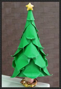 How to Fold an Origami Christmas Tree - http://www.papercraftsquare.com/fold-origami-christmas-tree.html