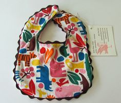 Sew Country Chick- Farmhouse Couture: How to make a rick rack trimmed baby bib - CraftStylish