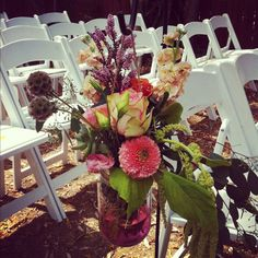 Hanging mason jars wedding flowers by Travis Payne
