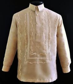 Raya Mocha Organza Barong Tagalog #4800 A sharp style for an impeccable formal look. This mocha-colored raya organza barong is embroidered from front to back. It has a U-Shape embroidery in front. Embroidery at the sleeves, at the sides, and at the back start from the top and end at the bottom of the barong. #BarongsRUs #b