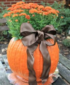 Mumpkins are the perfect way to display fall wedding flowers. Pumpkin carving has never been so elegant. I love these as DIY wedding centerpieces or aisle liners.