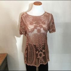 Lace short sleeve top Boho chic top with lace crochet detailing. Top is semi sheer. 51% cotton and 49% polyester. I am selling because it is too large for me. Gently worn, no rips, stains or tears. Smoke free home. No trades so please don't ask  Lapis Tops Blouses