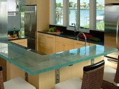 I love glass countertops! Beautiful.