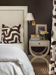 Neutral bedroom - dark brown walls - bold print pillows and drapes - Melanie Turner