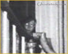 The first time that picture was shown was on the Merv Griffin show back in 1979. It was discovered 3 years after it was taken. Gene Campbell, who was a professional photographer, was brought into the house in 1976 when the Warrens went in with their team. He set up an automatic camera on the 2nd floor landing that shot off infrared, with black and white film throughout the night. There are literally rolls of film with nothing on them. There's only one picture of the little boy. George Lutz..