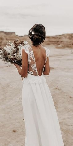 27 Bohemian Wedding Dress Ideas You Are Looking For Engagement and Hochzeitskleid Hochzeitskleid Open back wedding dress with sheer lace straps and large waterfall bouquet with pampa Engagement and Hochzeitskleid 2019 Wedding Dress Tea Length, Wedding Dress Black, Open Back Wedding Dress, Wedding Dress With Veil, Bohemian Wedding Dresses, Wedding Dress Styles, Wedding Bride, Summer Wedding Dresses, Boho Gown