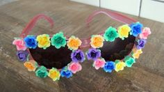 #ThePaintedCabeza ~ Ive embellished these fun & funky pink sunglasses with fimo flowers in shades of pink, blue, yellow, orange, blue, purple, and green. You WILL get noticed with these shades on