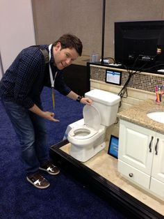 """The Guncles Blog: Must-Have Items from ABC Expo. """"Not something a new baby would use, but we had to mention their miniature toilets and vanities for kids! We mean… genius. And the toilets work with your existing plumbing."""" Bill Horn posing with our Child Size Manchester toilet!"""