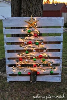 9. Or just put a lighted wood pallet against the tree. - 10 Cool Ideas to Decorate Garden or Yard Trees for Christmas