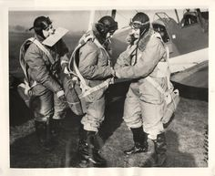"1940- Members of the Women Pilots' Section of the Air Transport Auxiliary adjusting parachutes before taking off ""somewhere"" in England."