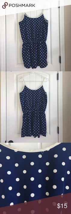 Polkadot romper. Polkadot romper. Has pockets and loops for a belt. Small loose string on back as shown in photo. 100% polyester. Smoke free pet free home. Forever 21 Other