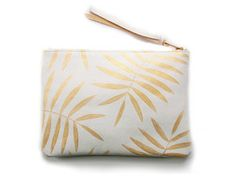 white gold palm leaf clutch