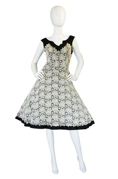 I found the exact same dress 3 years ago at a vintage fair for 1/10th the price I loved it but stupidly did not buy it...
