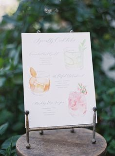 Watercolor drink menu is one of those little touches that makes a huge difference. https://www.stylemepretty.com/2018/01/10/an-alfresco-celebration-in-the-mountains-of-malibu/ PHOTOGRAPHY Kurt Boomer | EVENT PLANNING Sarah Park Events | FLORAL DESIGN Poppy Design Co. | INVITATIONS Custom Crafted | LINENS La Tavola Fine Linen Rental | BACKDROP Davina Kim | RENTALS AND BACKDROP Iron Grace Rentals | DESSERTS AND CAKE Sweetlee Made