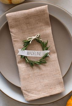 Mini wreaths are perfect for table cards, too. This one, made of fragrant rosemary, will smell divine but still drive home your winter theme.
