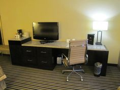 I love how our new entertainment centers for the Concourse Premier Rooms are a refrigerator, a TV table, a wardrobe, and a desk all at the same time! Madison, Wisconsin Hotel.