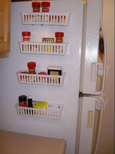 storage. sersiously?! awesome  An easy way to save space and store ingredients is with a magnetic basket. Just glue strong magnets onto whatever baskets appeal to you, then stick on the refrigerator.