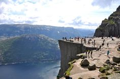 Fjords and the Preikestolen cliff in #Norway-The top of the cliff is approximately 25 by 25 metres (82 by 82 feet), almost flat, and is a famous tourist attraction in Norway.The cliff overlooks the densely and colorful green valleys of the Ryfylke region. The mountains surrounding the cliff reach heights of up to 843 meters. Some of the hilltops have plains which are interspersed with lakes.