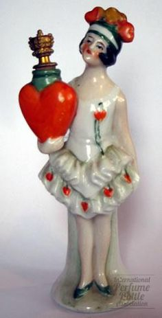 Not a half doll . . . but I like her anyway.  Porcelain German flapper perfume bottle, circa 1920s