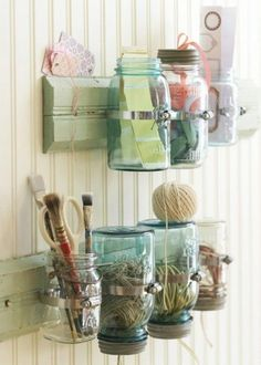 Mason Jar Storage - take an old board and paint it whatever color you want. Nail pipe clamps to the board for holding the mason jars. Then simply add the mason jars and tighten the clamps so that they hold well. Hang the board on the wall and fill with bathroom, nursery or other supplies.