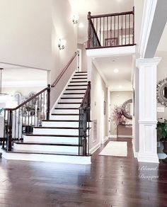 Traditional staircase. Paint color is Sherwin Williams Perfect Greige. The front doors open to a large foyer with an elegant traditional staircase. #traditionalstaircase #staircase traditional-staircase Home Bunch Beautiful Homes of Instagram @blountdesigns