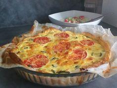 poivre, oeuf, crême fraîche, courgette, tomate, pâte feuilletée, fromage de chèvre, sel, lardons, fromage râpé