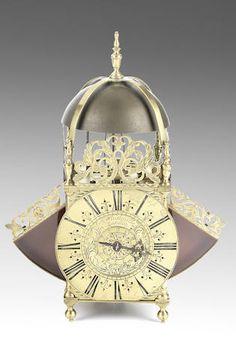 An early 18th century winged lantern clock J. Windmills, London