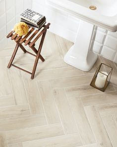 Light faux-wood tile layed in herringbone pattern.